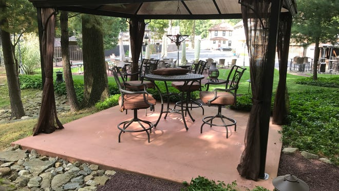 The outdoor eating and drinking area at Tree Tavern Wine Bar in Wanaque, N.J. pictured Oct. 5, 2017. The owner won approval for an expansion of the area following 14 months of hearings before the Board of Adjustment. The matter will likely face additional legal scrutiny in the courts.