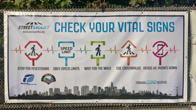 """A """"Check your vital signs"""" cautions pedestrians and drivers during a month-long """"Street Smart"""" campaign in Boonton."""