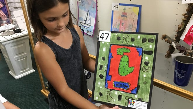 Marysville third-grader Lana Berger shows her Minecraft-inspired, Michigan-themed piece displayed at A Little Something on Friday during Art Hop in downtown Port Huron.