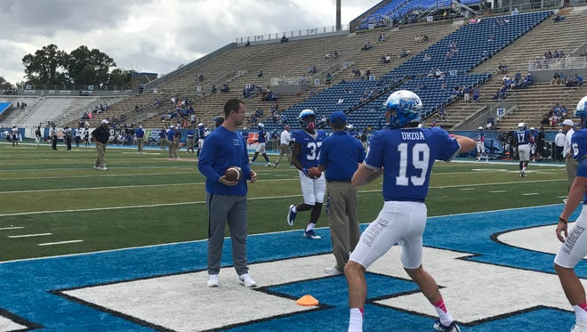 MTSU quarterback John Urzua warms up ahead of a game against FIU on Oct. 7, 2017.