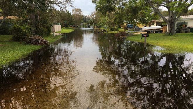 A street west of Fiske Boulevard in an unincorporated area of Brevard County near Rockledge remains flooded Sunday