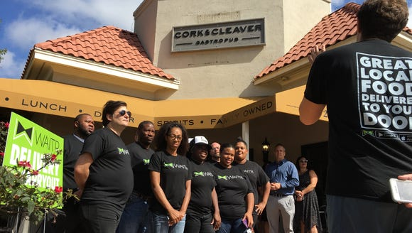 Waitr drivers gather outside Cork & Cleaver Gastropub
