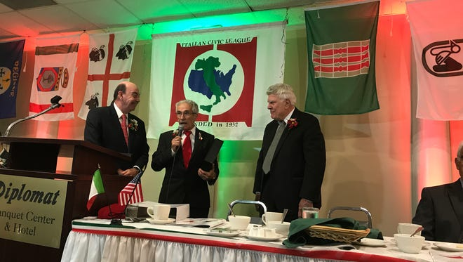 Quintino DiCesare, center, president of Italian Civic League, at Columbus Day luncheon with retired state Supreme Court justice Joe Valentino, left, and attorney Franklin D'Aurizio.