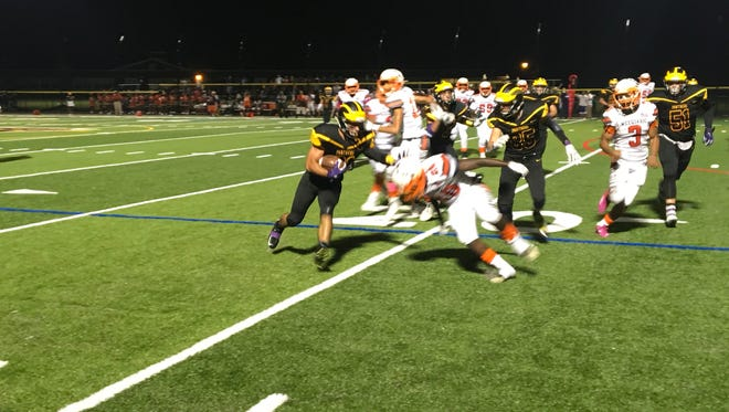 Cedar Grove running back Ryan Turi avoids a tackle against Weequahic.
