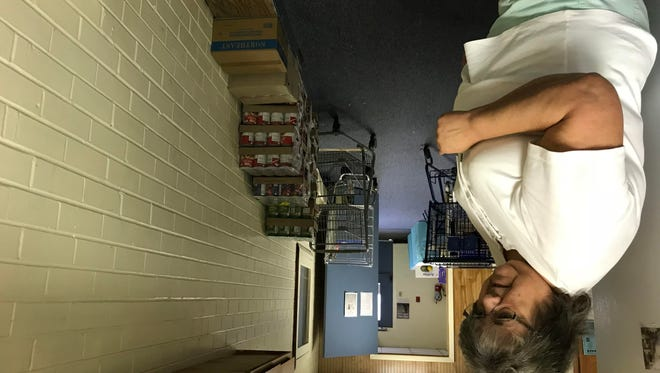 Grand Ledge Food Pantry Director Mary Holz points out stacks of food against a wall that usually stand at least four feet high. The pantry's needs are high, and its finances won't cover the non-profit's requests through the end of the year.