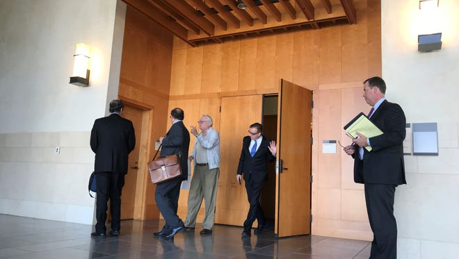 Tulare Regional Medical Center hospital officials exit a federal courtroom in Fresno after a hearing on Thursday.