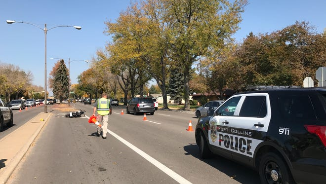 Police investigate a fatal motorcycle crash on College Avenue near Drake Road on Friday, Oct. 13.