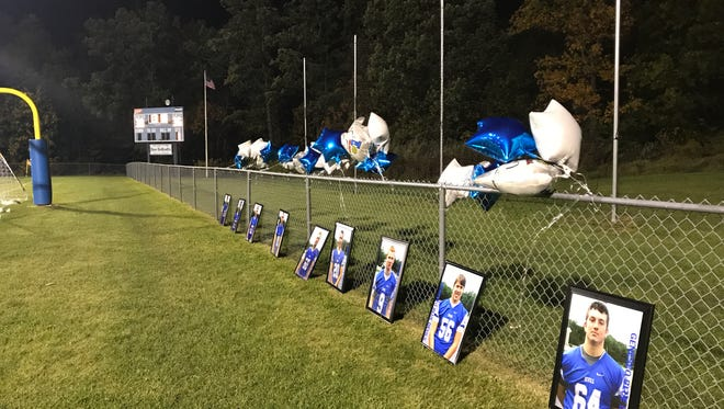 Seniors are honored with photos and balloons that decorated the Geneseo Central School Districts field.