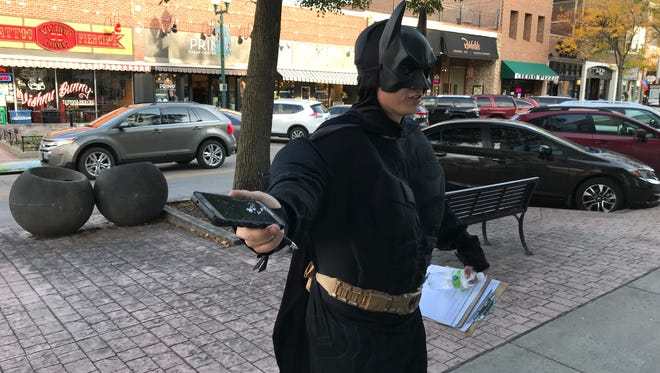 A man dressed as Batman was collecting petition signatures Friday in downtown Sioux Falls. The man declined to comment.