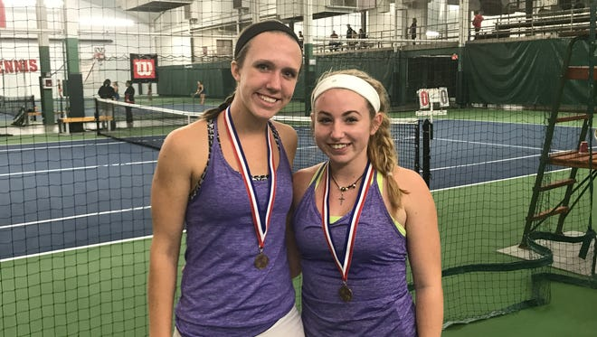 New Berlin Eisenhower's Gabby Majinski (left) and Samantha Ramsey pose with their medals after taking fourth place at the state tennis meet in Madison.