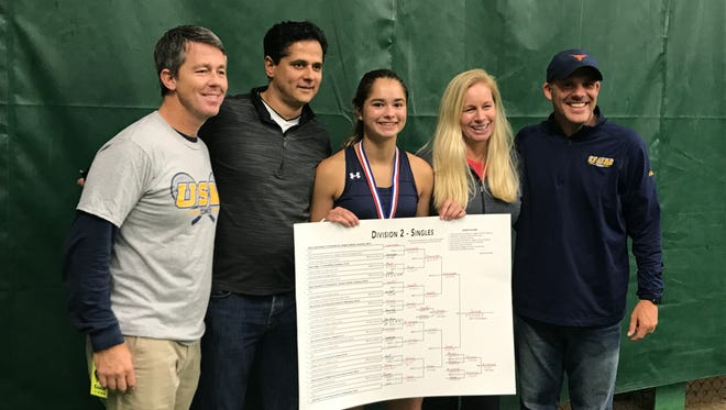 Vida Sane (center) poses for photos after winning the WIAA Division 2 tennis title Saturday.