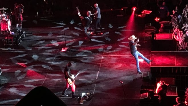 Jason Aldean and his band during an Oct. 14 at The Ford Center. This is his third concert after he rushed off the stage in Las Vegas during the mass shooting there that left 58 dead and more than 500 injured.