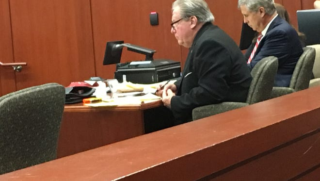 Former Brevard County Clerk of Courts listens a potential jurors are questioned in his public corruption trial.