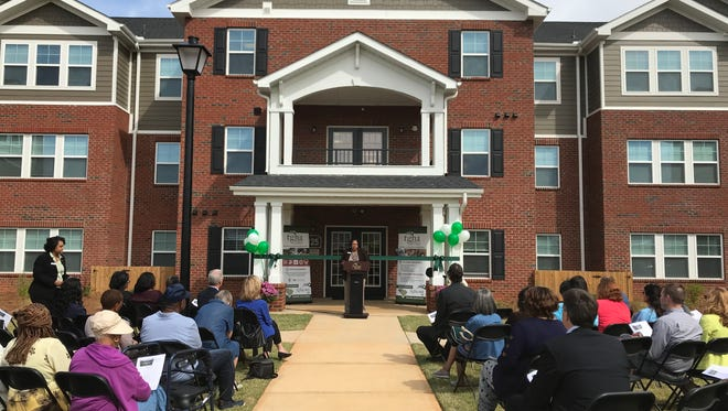 A ribbon-cutting celebration was held Monday for Greenville Housing Authority's new senior housing community, Heritage at Sliding Rock, in Nicholtown.