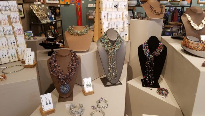 The necklace pictured on the right was taken in early October. Just a few days after employees at Trimble Court Artisans noticed it  had been stolen, someone anonymously mailed it back to the shop.