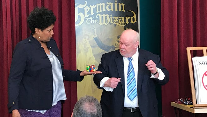 CBS Sunday Morning contributor Nancy Giles assists magician Ron Carnell during his Wednesday performance at the American Museum of Magic.
