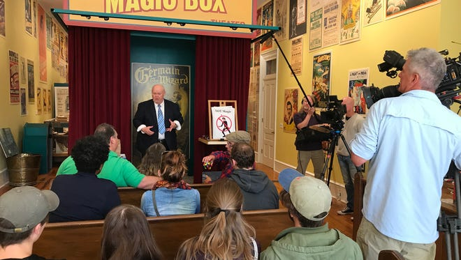 Magician Ron Carnell performs for a group of Olivet College students at the American Museum of Magic Wednesday while a CBS Sunday Morning crew records him.