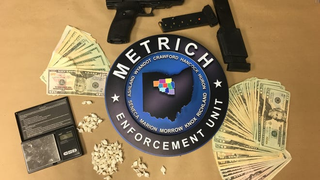 An Ashland detective stopped a suspected drug deal in a Walmart parking lot on Monday, leading to one arrest and the seizure of suspected drugs, cash and a firearm.