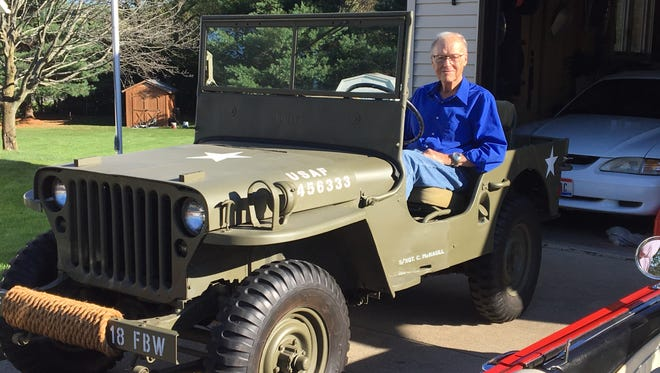 Korean War veteran Cloyd McNaull sits in a World War II-era Jeep he restored on Tuesday, Oct. 17, 2017, at his Ashland home. McNaull is being inducted into the Ohio Veterans Hall of Fame.