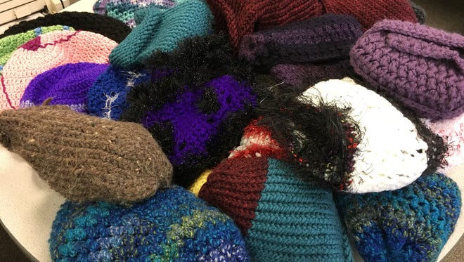 Some of you are making matching scarves and stuffing them into the hats they match. Very nice!
