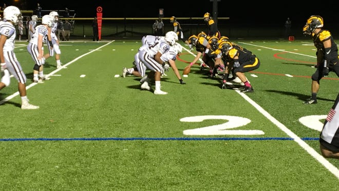The Cedar Grove offensive line kept the Pascack Hills defense in check in the Panthers 35-20 win.