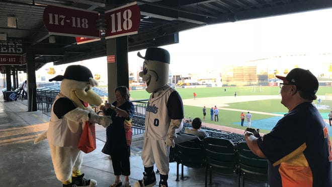 Hooks fans and season ticket holders David Rivera, left, and his wife Diana, take pictures with mascots Rusty Hook and Sammy the Seagull at Whataburger Field on Tuesday, Oct. 24, 2017.