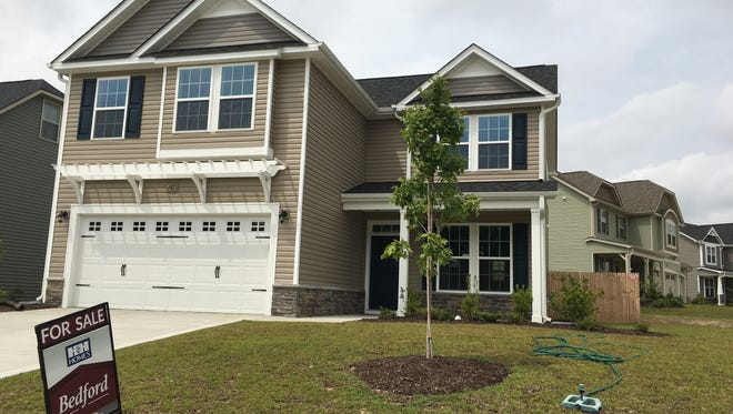 This Wednesday, Sept. 6, 2017, photo shows a new home for sale in a housing development in Raeford, N.C. On Wednesday, Oct. 25, 2017, the  Commerce Department reports on sales of new homes in September.
