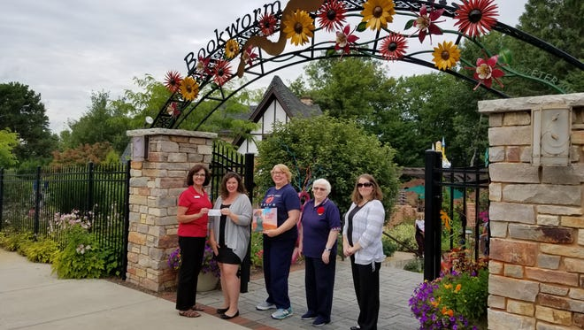 American Legion Auxiliary Council donated $2,500 check to Bookworm Gardens