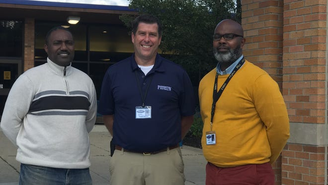 Farmington High School Principal Tom Shelton (center) flanked by assistant principals Lawrence Stroughter (left) and Tyrone Weeks.