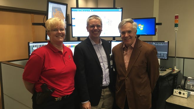 The Sheboygan County dispatch center has implemented a new system that allows dispatchers to provide medical care directions to callers. Pictured, from left, Kristine DeBlaey, Sheboygan County Sheriff's office; Dr. Steven Zils, Aurora Health Care, and Ben Salzmann, CEO, Acuity Insurance.