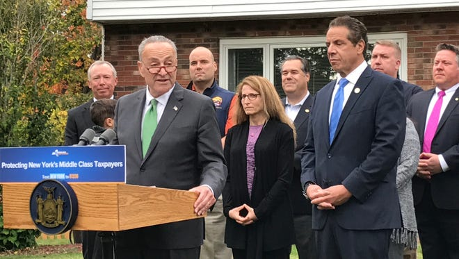 Sen. Charles Schumer and Gov. Andrew Cuomo spoke Monday, Oct. 23, 2017, at a home outside Albany about the impact of New York losing its state and local tax deduction in a federal tax overhaul.