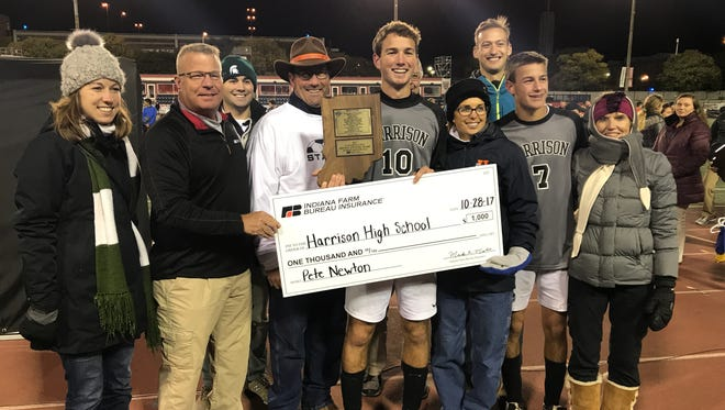 Pete Newton receives the Eugene C. Cato Mental Attitude Award at Saturday's boys Class 3A soccer state championship.