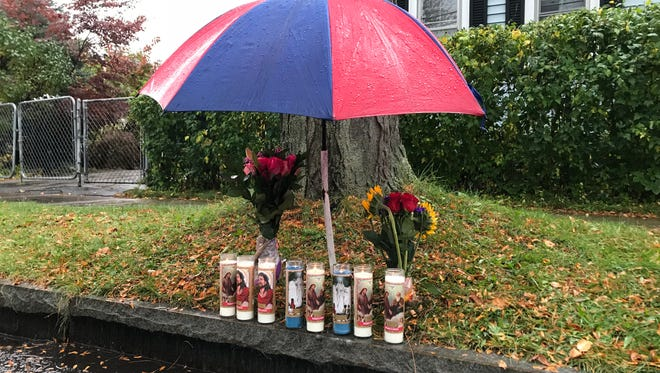 A small memorial outside a home on Scrantom Street where a man was shot and killed early Saturday morning.