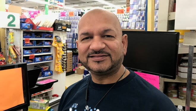 Mel Desai, manager of Super Exito Supermarket in Clifton's Botany Village section.