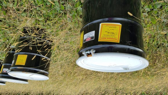 Drums of hazardous waste found along a rural road in