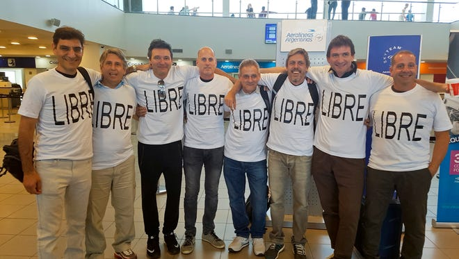 Hernan Ferruchi, Alejandro Pagnucco, Ariel Erlij, Ivan Brajckovic, Juan Pablo Trevisan, Hernan Mendoza, Diego Angelini and Ariel Benvenuto, gather for a group photo before their trip to New York City, at the airport in Rosario, in the province of Santa Fe, Argentina. Mendoza, Angelini, Pagnucco, Erlij and Ferruchi were killed in the bike path attack near the World Trade Center. They were part of a group of friends celebrating the 30th anniversary of their high school graduation with a trip to New York City.