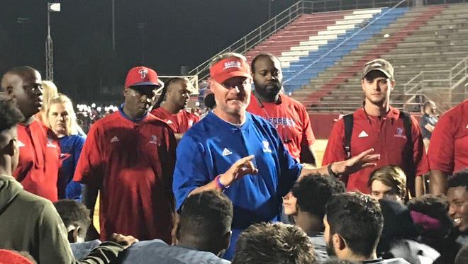 Pine Forest head coach Jason McDonald talks to his team after beating Milton on Friday night.