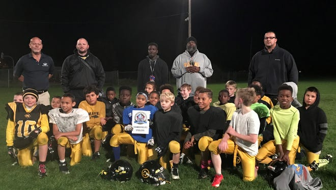 The Chambersburg Steelers pose for a picture after earning an invitation from the Pro Football Hall of Fame