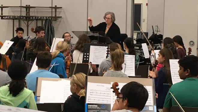 Kathleen Yeater conducts the York Junior Symphony Orchestra during a Saturday morning rehearsal.