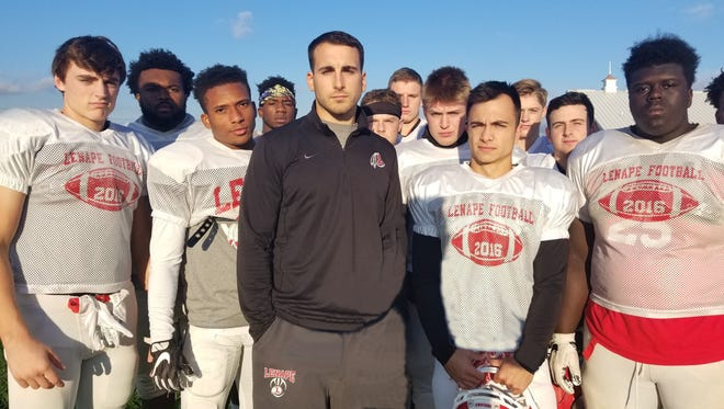 Joe Wojceichowski, center in black, is seen here with the Lenape High School football defense he coordinated last season. He was named the Indians' next head coach on Wednesday.