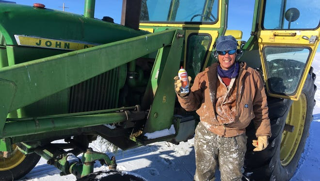 Lisa Schmidt has a back-up can of starting fluid, but didn't need it to start the tractor on this cold, sunny day.