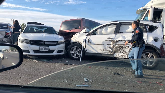 Police investigate a nine-vehicle crash on Interstate 10 East near the Lee Treviño Drive exit ramp Thursday. A woman died Friday from injuries sustained in the crash.