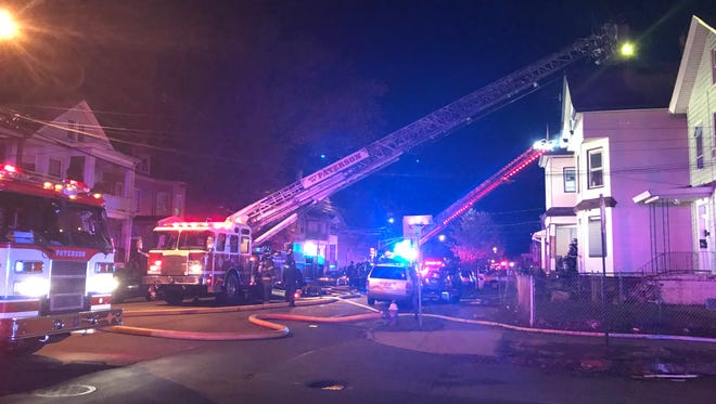 Firefighters battle a blaze on 14th Avenue in Paterson Nov. 10, 2017.