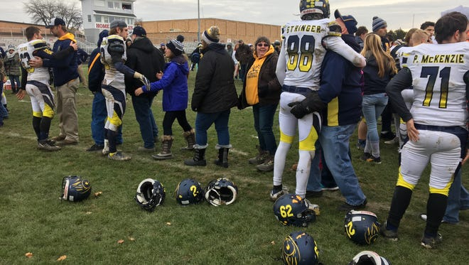 The Algonac High School football team is greeted on the field by parents and fans after losing to Frankenmuth Saturday.