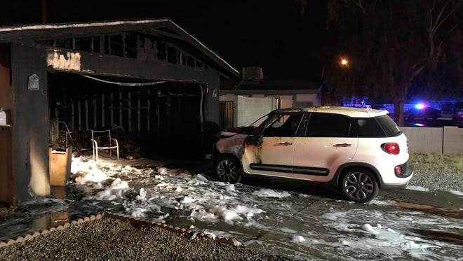 Garage house fire indicates vehicle's engine as the cause for the fire.
