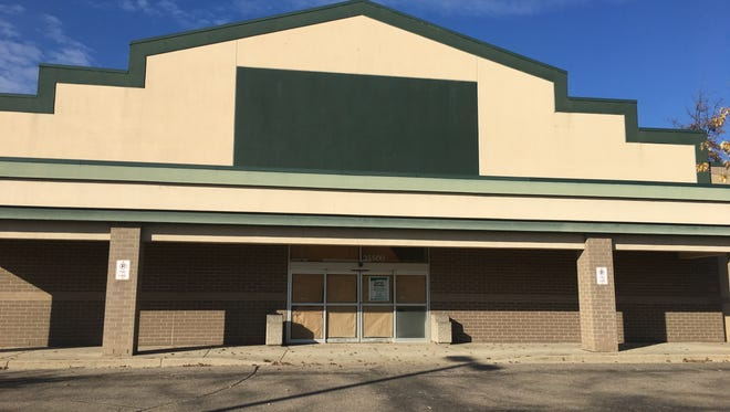 A former Dick's Sporting Goods store in a soon-to-empty Westland shopping plaza.