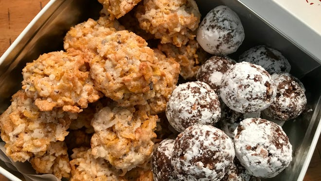 Corn Flake coconut macaroons, left and rum balls were award winners in a 1954 Indianapolis Star cooking contest.