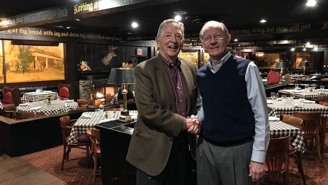Paul Pehrson (right) stands with Hans Schuler, CEO of Schuler's Restaurant & Pub. Pehrson has worked for Schuler, Schuler's grandfather, his father and his son.
