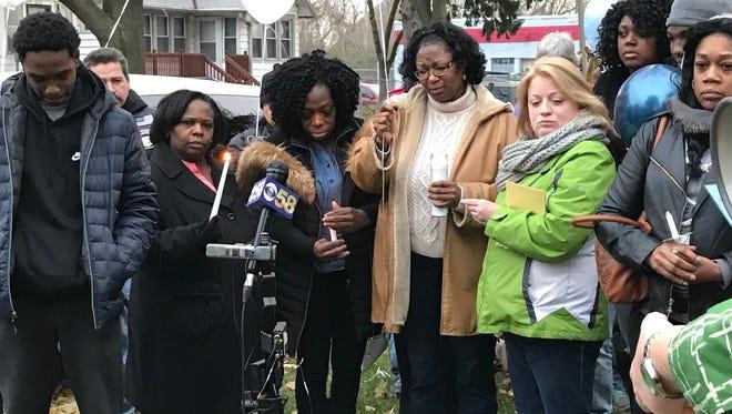 Brenda Hines (center in tan coat) remembers her son, Donovan, during a vigil. Donovan Hines was fatally shot on Nov. 13.
