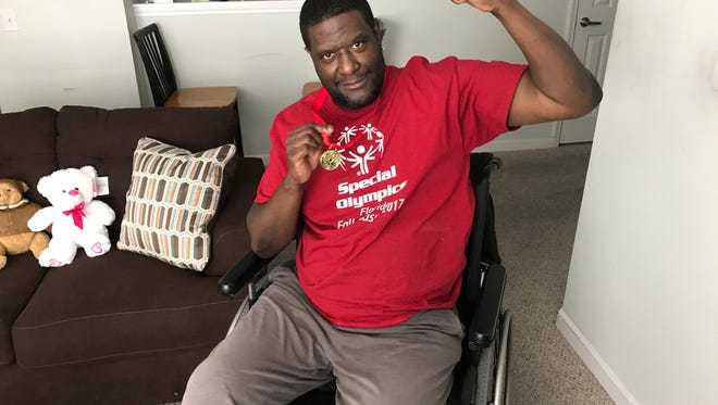 Eric Sarvis, 56, won a gold medal at the Special Olympics on Nov. 12 in Orlando.